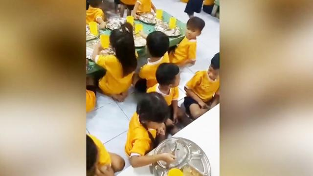 Heartwarming moment big sister feeds little brother on first day at school