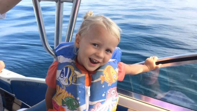 Little girl can make a whale appear with the wave of her hand