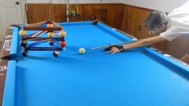 That'll do the trick! Watch as this 14-year-old pool player bends it like Beckham