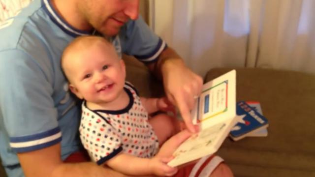 Daddy Grabs A Book To Read But It's Baby's Snappy Comeback That Has Internet In Laughter