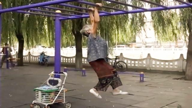 An 80-year-old woman showing off her amazing gymnastic skills