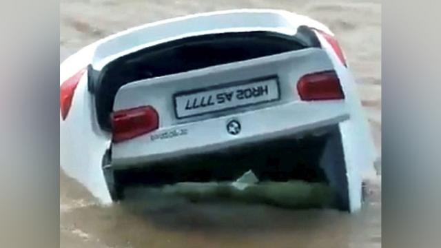 Arrogant son pushes BMW given to him into river because he wanted a Jaguar