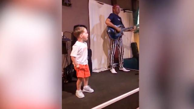 Aspiring 3-year-old star jumps on stage to steal the show from actual performer, resulting in a full