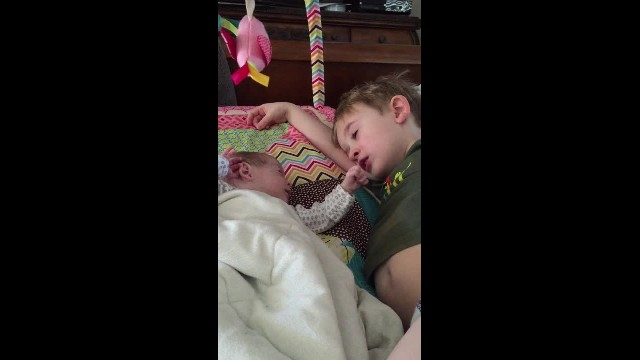 Big brother singing and crying about preemie baby sister. Amazing moment of love!