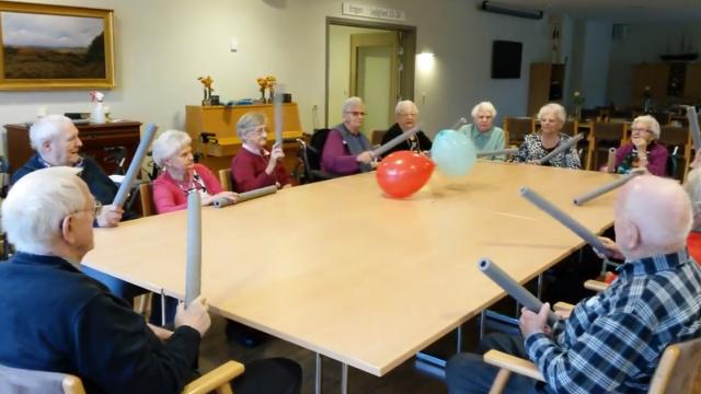 Elderly Playing With Balloons