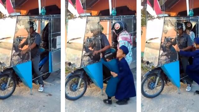 Easy drier! Moped rider keeps family out of rain with bizarre