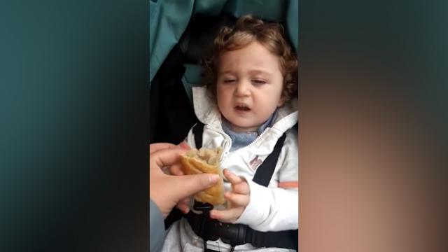 Watch Sleepy tot can't keep eyes open but clutches Gregg's sausage roll like life depends on it
