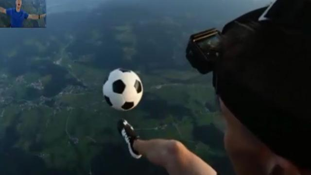 Two British artists do football freestyle on hot air balloon