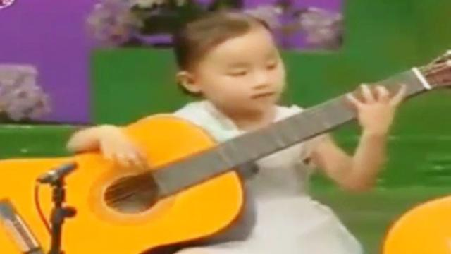 A group of children played guitar beautifully that made adults admire deeply