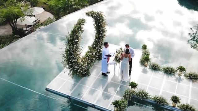 One-of-a-kind wedding ceremony lets couples walk down floating isle in paradise