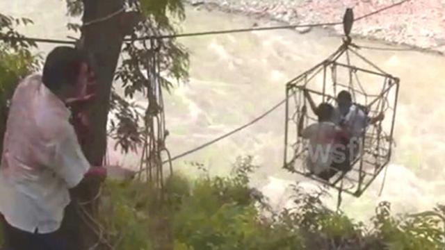 Children risk their lives using trolley 100 feet over river to reach school