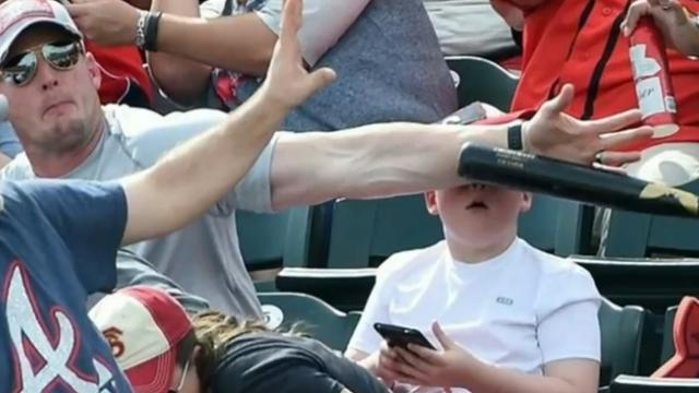 Dad Saves Son and Photo Goes Viral. Look at Him Compared to other Fans Around Him