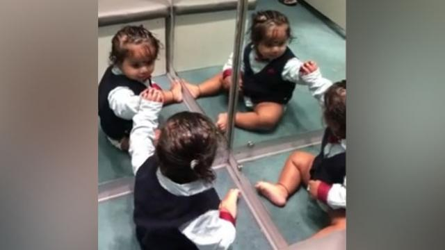 Baby boy left adorably confused by his reflection