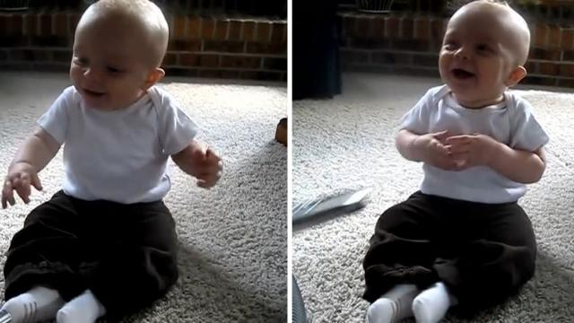Baby can't stop laughing at vacuum