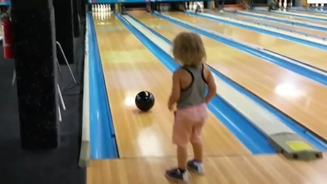 Strike three – Toddler bowls perfect ball