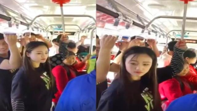 Chinese woman uses plunger as a makeshift handle on bus