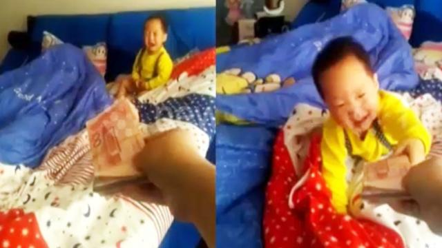 Baby stops crying when he gets money