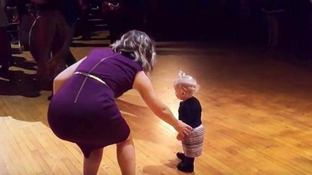 Baby girl steals the show at a ballroom showcase