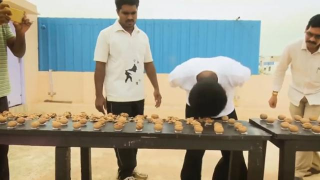 Indian man cracks 217 walnuts with his head
