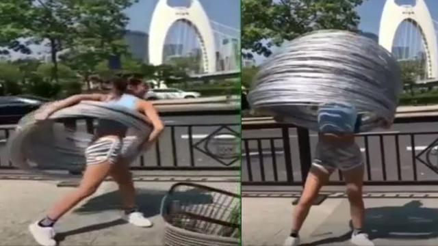 Amazing video Chinese girl twirls nearly 300 hula hoops simultaneously