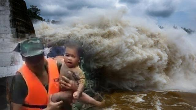 Moment four-month-old baby is rescued from Laos flood