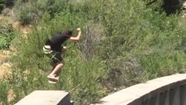 Skateboarder Performs Tricks On Edge Of 200ft Dam