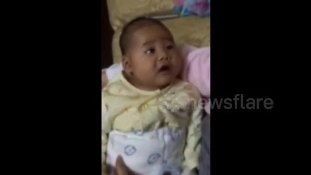 Laugh out loud when a lovely baby learns to whistle with his dad