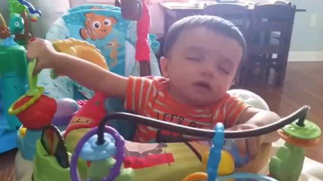 Ridiculously Cute Toddler Finds A Way To Drift Off To Sleep That