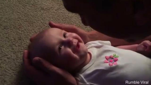 viral video of a father singing to his cute baby daughter.