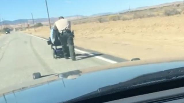 Wheelchair Won't Fit In Patrol Car, So Deputy Gets Out & Starts Pushing.