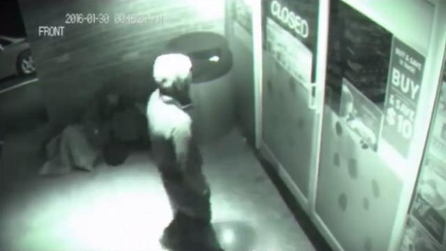 Spooky CCTV footage shows a mystery man walks right through