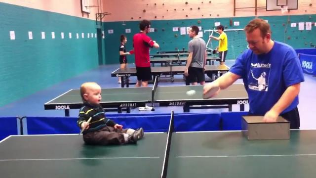 Dad Plays Ping Pong With Baby Boy