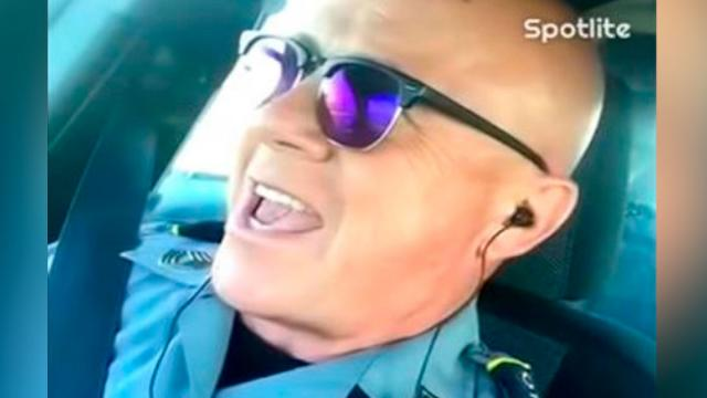 Cop Films Himself Inside Police Cruiser Making Everyones Head Spin Instant He Starts To Sing