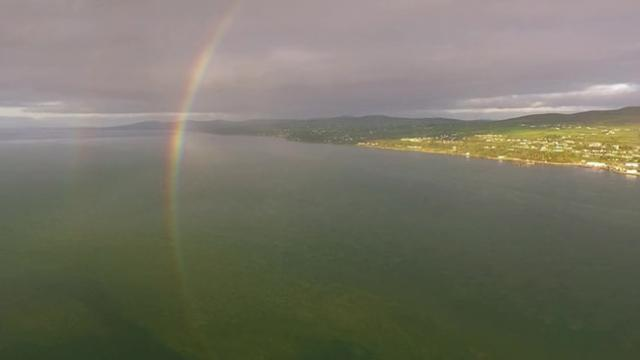 Drone captures beautiful rainbow curving underwater in