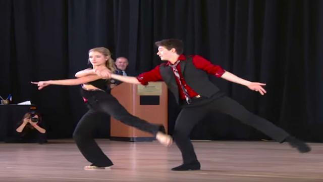 15-year-old boy grabs her hand to dance and wows crowd with world champion routine
