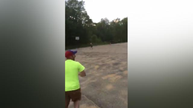 Man Throws Frisbee Into Basketball Net From Ridiculous Distance