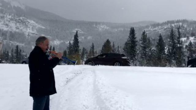 Trumpeter Stuck In Snowstorm Entertains Hundreds of Stranded Motorists