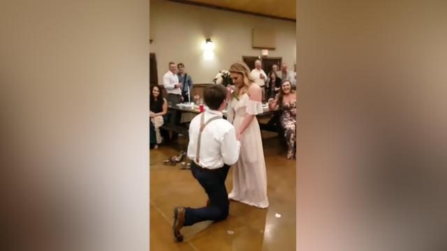 Man Surprises Girlfriend by Proposing at Family Wedding