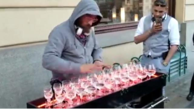 Street Performer Amazes Viewers When Playing Mozart on Water Glasses